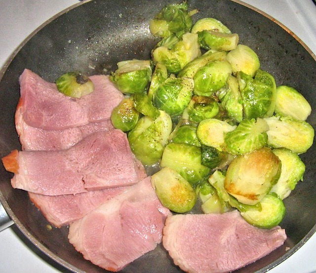 Brussels Sprouts frying in pan with sweet country ham