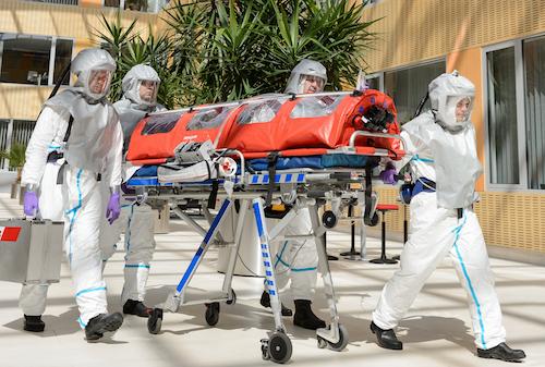 hazmat crew removing a body