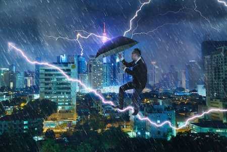 man in storm with umbrella