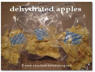 Dehydrated Apples with their 100cc oxygen absorbers tucked in. Easy Food Dehydrating.