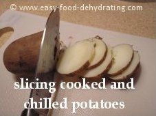 Cooked potatoes being sliced
