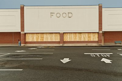boarded up grocery store