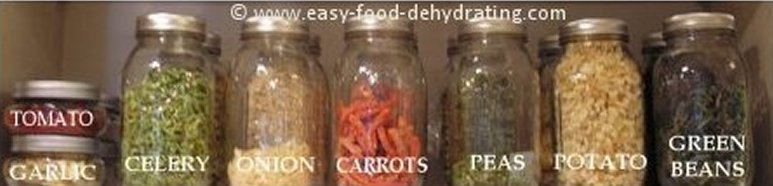 Filled Mason jars of dehydrated food in kitchen cupboard