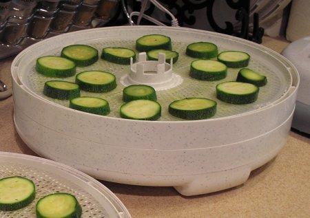 Sliced zucchini on Nesco dehydrator